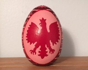 """Polish Falcon handpainted wooden egg in shades of reds 2.5"""" tall"""