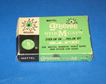 Vintage 1958 Mattel Greenie Stik-M-Caps Empty Box Used With The Mattel Shootin' Shell Toy Cap Guns In Very Good To Excellent Used Condition.