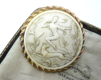 Vintage goldtone Art Deco hunting goddess celluloid brooch