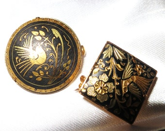 Two pretty  vintage 1950s black and gold damascene swallow bird brooches