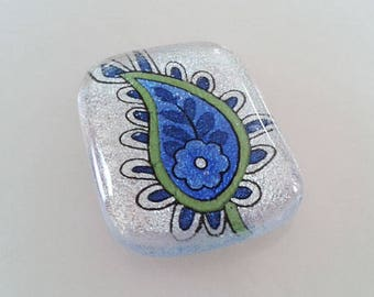 Dichroic glass cabochon, blue paisley floral pattern on silver dichroic glass