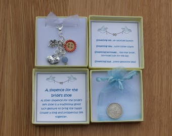 Silver sixpence for the bride's shoe. Wedding bouquet charm. Bridal charm. Something old, new, borrowed and blue. Bride good luck gift.