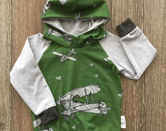Quantity limit sweater hooded for baby and child, on grounds of aircraft on a green background, pale grey sleeves