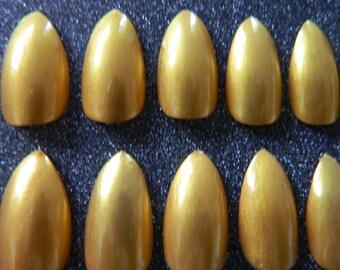 Gold Stiletto Nails.