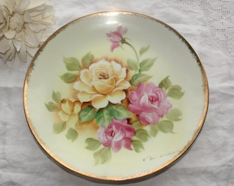 Japan: Hand painted and signed plate, yellow and pink flowers