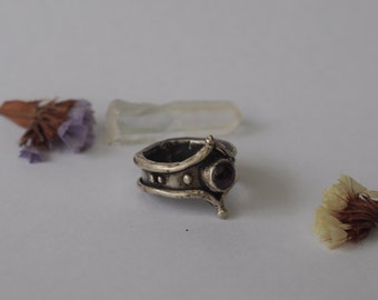 Handmade silver ring with garnet stone.