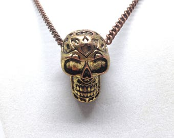 Intriguing Human Skull Gold Tone Necklace