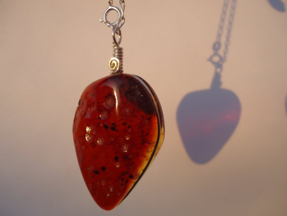 Mexican red amber strawberry shape pendant, set on sterling silver wire, handmade, unique