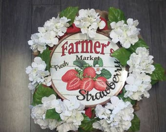 Fresh strawberries sign on green and red burlap wreath with flowers