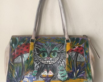 """Beige designer bag, real leather, soft leather, bag has unique printed picture - """"Cheshire Cat from Alice in Wonderland"""", new, size-medium."""