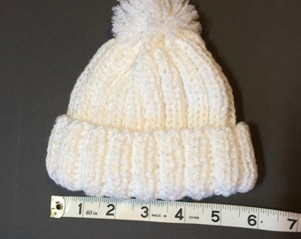 Small child's white hat.