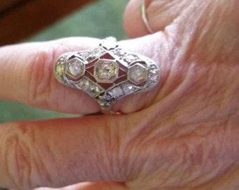 Vintage platinum and 18 kt diamond ring