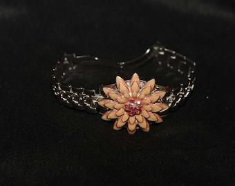 Pink enamel flower