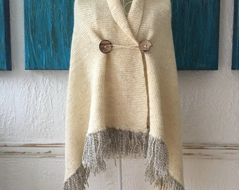 Organic wool shawl/wrap/poncho with fringes with coconut shell buttons.Hand knit shawl.Hand knitted Blanket scarf.Wedding hand knitted shawl