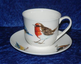 Garden Birds cup and saucer set. Bone china cup and saucer set decorated with Robin, Bluetit and chaffinch