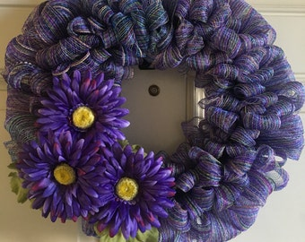 Summer wreath with purple daisies