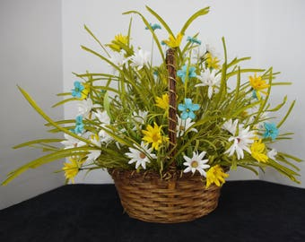 Silk Arrangement of Yellow and White Daisies and Blue Wildflowers in a Wicker Basket