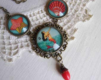 La Sirena mermaid necklace with shell and starfish accents