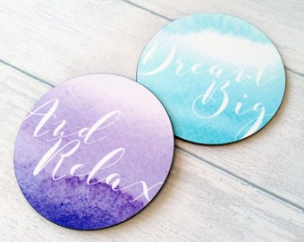 Glossy round gift set of 2 coasters, featuring my watercolour wash and script designs.