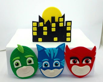 PJ Masks Catboy, Owelette and Gekko 2D Fondant masks and night skyline birthday cake topper decorations.