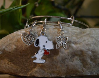 This lovely bangle bracelet with snoopy butterfly and heart
