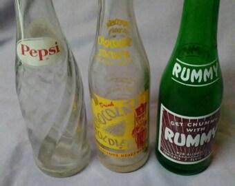 Set Of Three Vintage Glass Soda Bottles