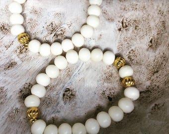 Pair of Bone and Brass Bracelets
