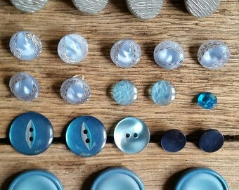 Selection of vintage buttons in shades of pale blue to turquoise.