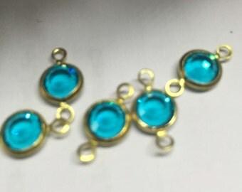 Swarovski component - intermediate section with 2 eyelets - blue zircon - gold - 7 mm