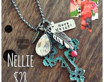 The Nellie Cross Necklace can be written long or short