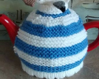 Hand-knitted pasty-pinching seagull Cornishware tea cosy.