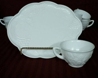 Vintage milk glass serving tray with cup. Grape vine pattern. 8 sets available.