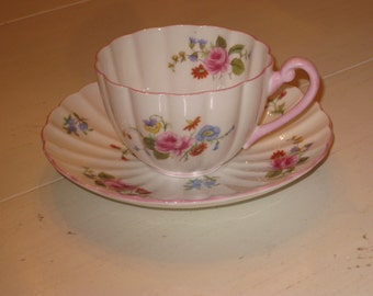 Shelly Teacup and Saucer with floral design and vintage age