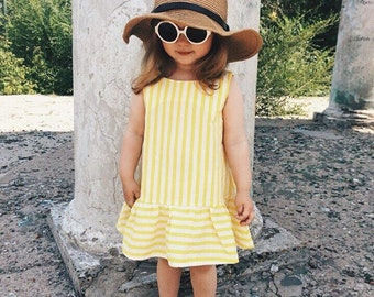 Girls dress yellow and white stripes by Berry and kit ,Light A line dress with ruffled hem finish.
