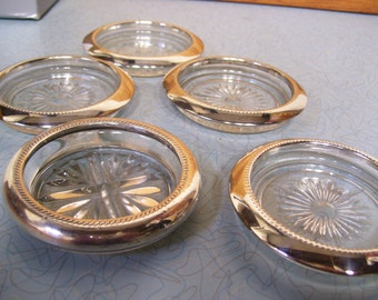 Vintage glass and chrome coaster set