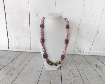 Beaded necklace with purple and silver beads.