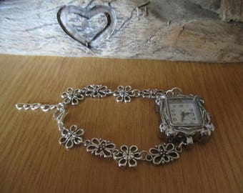 Watch Bracelet with a Square Face and Silver Coloured Flowers