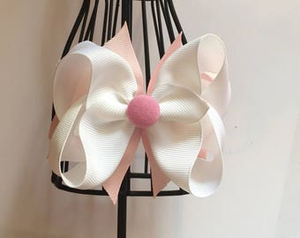 Pink and white button bow