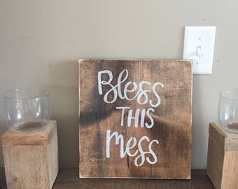 Brown bless this mess sign