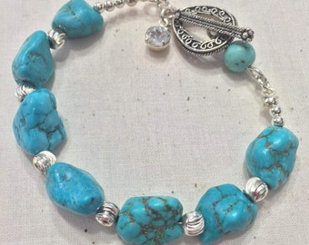 Sterling silver and turquoise bracelet with toggle clasp
