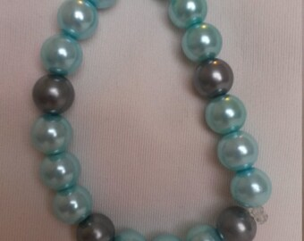 pearlescent blue and grey elasticated beaded bracelet