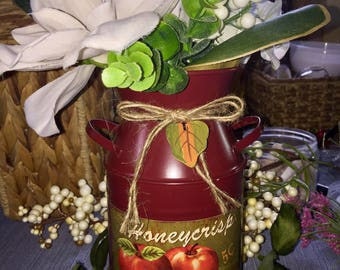 Country charm faux Magnolia bouquet in apple tin can.