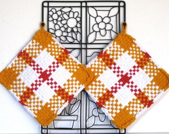GK's Kitchen - One Pair - Orange Burnt Orange and White Plaid Potholders.   Item # GK's Kitchen - Fall 00303