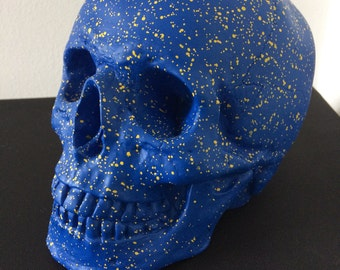 Blue and yellow splatter skull