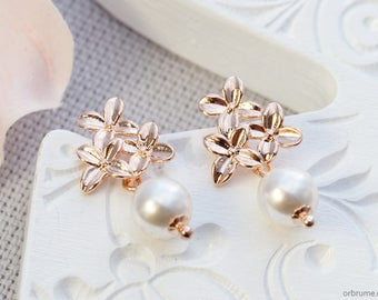 Tehani | Swarovski pearl and rose golden flowers | Floral dangle earrings with white pearl
