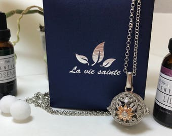 Real cubic zirconia, stainless steel essential oil locket and chain.