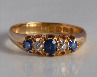 18 k gold Victorian ring from 1897 with natural sapphires and diamonds