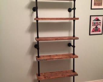 Floor to Ceiling Reclaimed Scaffold Board & Steel Pipe Shelves