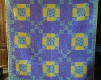 "New warm and cozy flannel lavender and yellow twin size quilt, 65"" X 65"" , made in USA."
