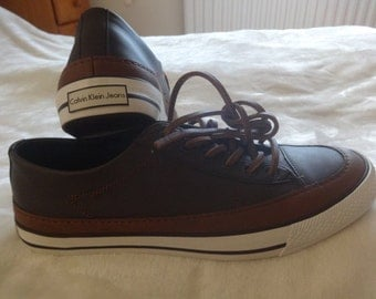 Brand new Calvin Klein leather trainers UK9